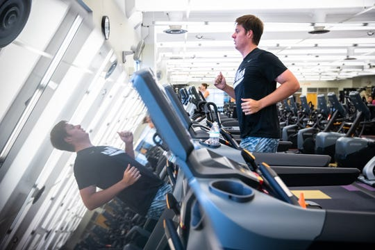 Matthew Marchel, of Greenville, runs on the treadmill at the Cleveland Street YMCA in Greenville, Monday, May 18, 2020, the first day that close-contact businesses, including gyms, barbershops and salons were permitted to reopen.