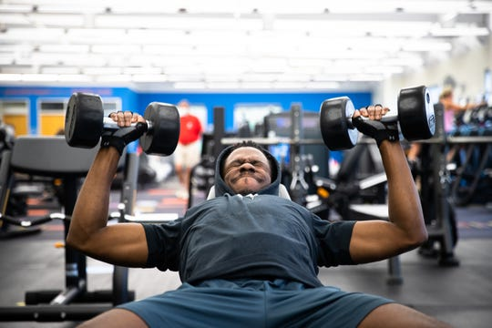 Kieron Hughes, of Greenville, works out with free weights at the Cleveland Street YMCA in Greenville, Monday, May 18, 2020, the first day that close-contact businesses, including gyms, barbershops and salons were permitted to reopen.