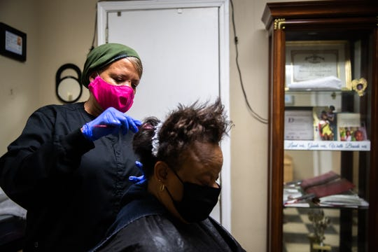 Louise Fant, owner of Snaz-Z Hair Salon in Anderson treats her cousin Teresa Mattress' hair with relaxer Monday, May 18, 2020, the first day that close-contact businesses were permitted to reopen. Fant had her first customer of the day at 1:30 am and is booked for the next two weeks.