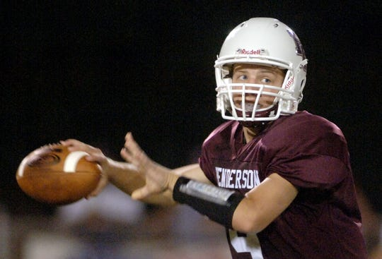 Henderson County quarterback, Jeremiah Coursey (9) looks for an opening against Evansville North in 2006 at Colonel Stadium.