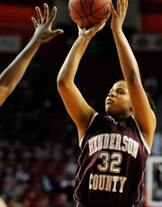With a hand in her face, Henderson County's Brooke Tapp takes a jump shot in the 2010 Sweet 16 in Bowling Green.