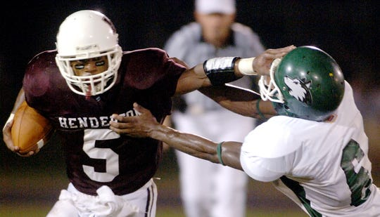 Henderson County's Antoinne Lightfoot pushes off Evansville North's Ryan Parkman in 2006 at Colonel Stadium.