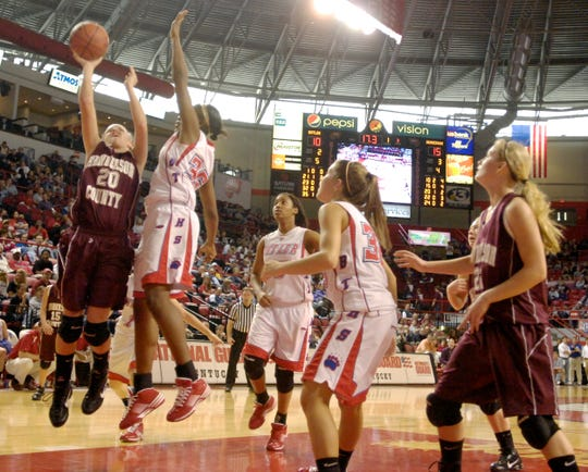 Henderson County's Lauren Rodgers goes up for a layup against Butler's Moriah Corey during the 2010 Sweet 16  in Bowling Green.