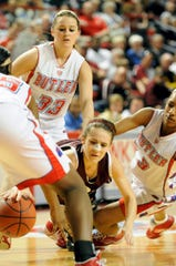 Henderson County s Ariel Barnes is tripped and fouled during the 2010 Sweet 16 in Bowling Green Wednesday.