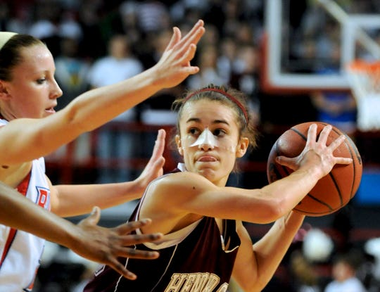 Henderson County's Ariel Barnes looks to pass under defensive pressure from Butler's Moriah Corey and Heather Wheat during the 2010 Sweet 16 in Bowling Green.