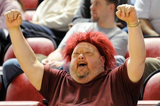 """Rick """"Poncho"""" Lambert, the Colonels official No. 1 fan,  cheers the Lady Colonels as they play Butler in the 2010 Sweet 16 in Bowling Green."""
