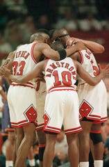 B.J. Armstrong huddles with Chicago Bulls teammates in this file photo from the 1993 NBA Finals.