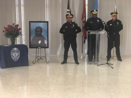 Jackson Police Department Capt. J.T. Gause stands guard to honor fallen officers from West Tennessee, including JPD Sgt. Andy Bailey.