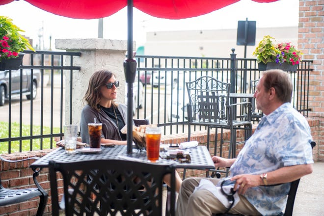 Customers sit outside at The Blacksmith restaurant Monday, May 18, 2020 in Jackson, Tenn. The Blacksmith allows customers to dine-in while following the CDC guidelines of social distancing.