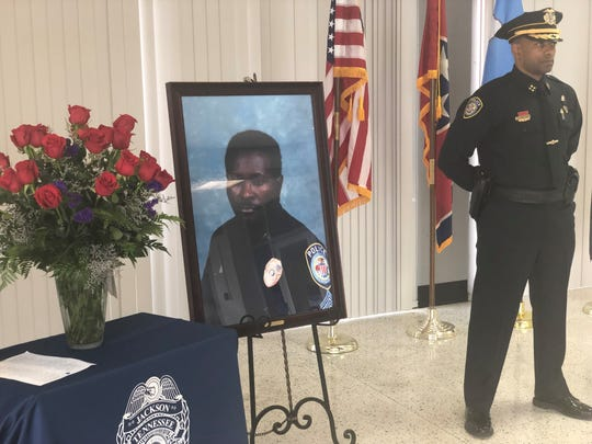 Jackson Police Department Deputy Chief Tyreece Miller stands guard to honor fallen officers across West Tennessee. The roses represent the 25 fallen officers, including JPD Sgt. Andy Bailey, killed in the line of duty in 2004.