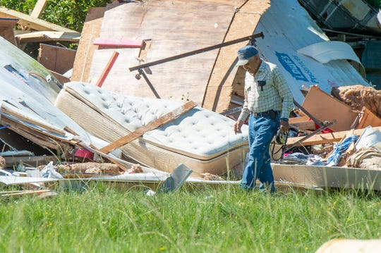 Martin Guillory surveys the damage of the home where a woman was killed by a suspected tornado that touched down on Prudence Highway near Churchpoint, LA. Monday, May 18, 2020.