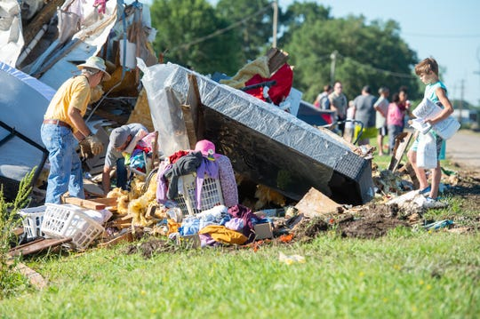 Phillip Thibodeaux Sr., left, salvages belongings from a home destroyed by a possible tornado on Prudence Highway near Churchpoint, LA. Monday, May 18, 2020.