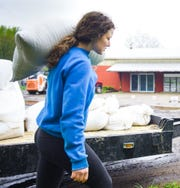 Elise Thorp, co-founder of Trillium Wood Farm in Williamston unloads grain for chicken feed Monday, May 18, 2020, at the farm she and sister Allie founded eight years ago.  She says they're having a hard time keeping up with demand for locally-raised meats, which they sell direct-to-consumer.
