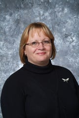 """Teresa Parker, author of """"Marion Technical College: The First 50 Years"""" in 1977 today."""