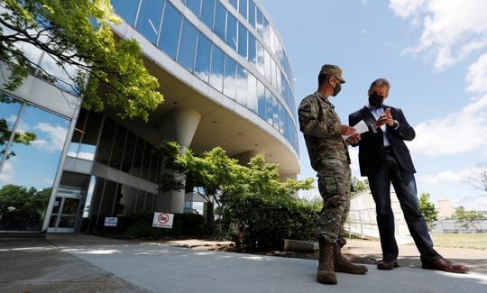 Gov. Bill Lee talks with Maj. Gen. Bob Whittle of the U.S. Army Corps of Engineers outside the former Commercial Appeal building at 495 Union on Monday, May 18, 2020.