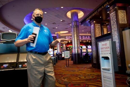 Senior Director of Marketing Jeff Strang talks to the media next to a hand sanitizer station at the entrance Monday, May 18, 2020, at Southland Casino Racing in West Memphis.