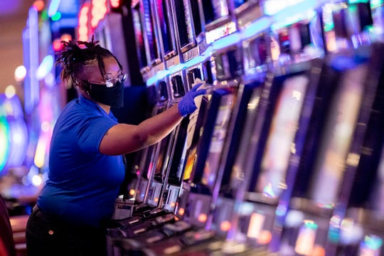 Ebony Morris of West Memphis cleans slot machines Monday, May 18, 2020, at Southland Casino Racing in West Memphis.