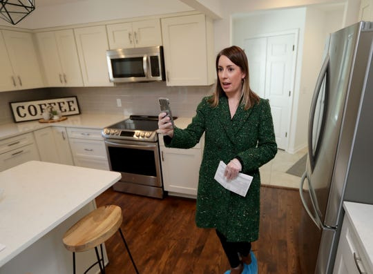 Stephanie Minnich, a realtor at Falk Ruvin Gallagher team of Keller Williams Realty uses FaceTime to show a prospective buyer a home in Bayside.  The local real estate market has had to make accommodations as the coronavirus restrictions continue.