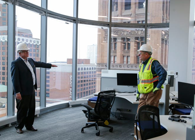 Mark Irgens, left, CEO of BMO Tower developer Irgens, and Timothy J. Gasperetti,  vice president of Irgens, give a tour of the building on March 24.
