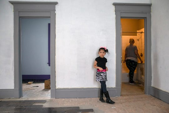 Lillyvanette Cuevas Colon, 6, walks around in the living room while her mother Sheila DeCuevas gets water from bathroom in their new house on North 7th Street. Acts Housing is a program that allows homeowners a chance to receive loans, financial advice and put sweat equity into properties that they buy as homes.
