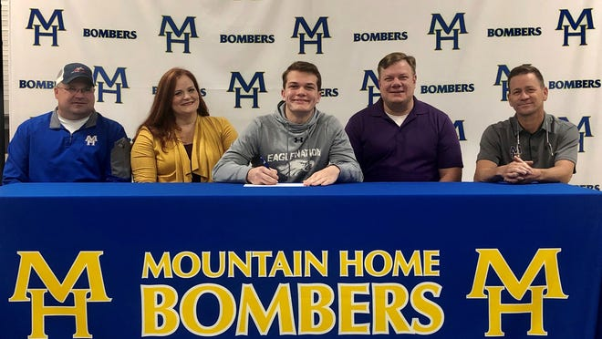 Mountain Home's Judah Lagg signed a National Letter of Intent on Monday to join the wrestling team at University of the Ozarks. Pictured at Lagg's signing ceremony are: (from left) MHHS wrestling coach Scott Callies, his mother Nerrylee Lagg, Lagg, his father Barry Lagg, and MHHS wrestling coach Travis Alexander.