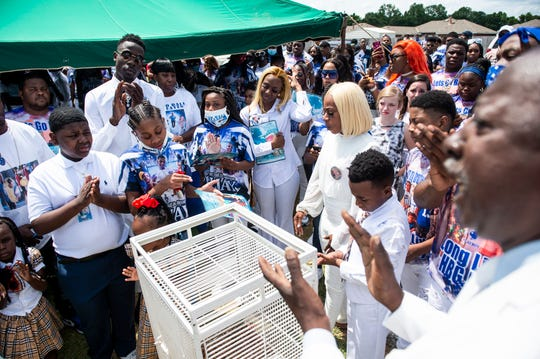 "The family of James ""Jay"" McGhee Jr. releases doves at Eastwood Cemetery in Montgomery, Ala., on Saturday, May 16, 2020. McGhee, 18, was shot and killed Wednesday May 6."