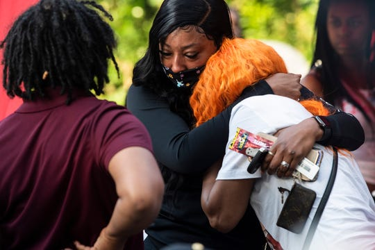 "Keyasha Erby mourns her son, James ""Jay"" McGhee Jr., during a candlelight vigil in Montgomery, Ala., on Wednesday, May 13, 2020. McGhee, 18, was shot and killed Wednesday May 6."