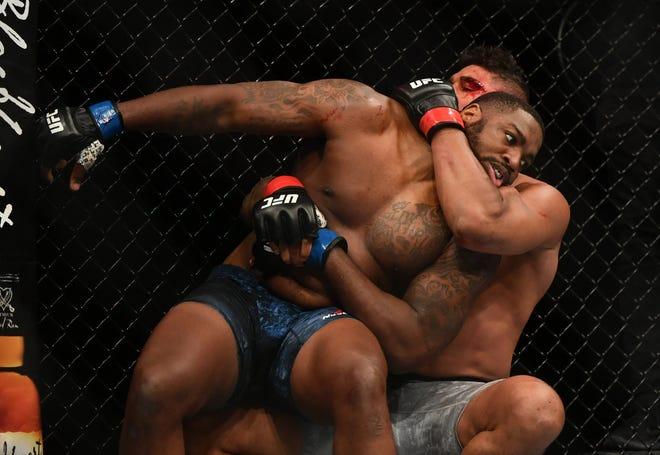 Alistair Overeem (red gloves) fights Walt Harris (blue gloves) during UFC on ESPN at VyStar Veterans Memorial Arena.