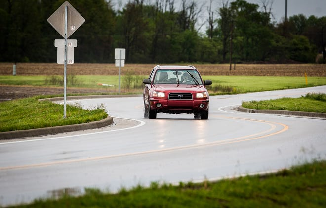 A car drives along Riggin Road near Walnut Street in Muncie Monday, May 18, 2020.