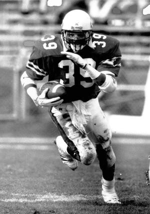 Bernie Parmalee runs the ball during his career playing for Ball State football in college. Parmalee is currently coaching in the NFL with the Atlanta Falcons.