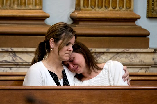 Jennifer Plummer holds her sister, Mary Massuros, during the plea hearing of Mary's husband, Jason Massuros. Jason Massuros pleaded guilty to causing the death of his child by leaving a loaded firearm out in his Pataskala home in December. Jason Massuros was sentenced to 6-9 years in prison.