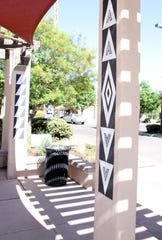 Jesse Kriegel has been working on the Leyendecker Plaza beautification project in the central hub of the Deming downtown business district. Kriegel, head of the Deming High School Art Department, has been commissioned by Deming MainStreet to paint the pillars at the plaza in the geometric patterns of the Native-American Mimbreño art culture. Deming MainStreet has also added lighting to the plaza.