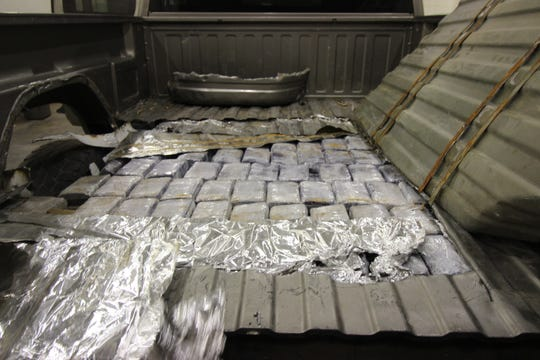 The bed of this pick-up truck contained 305 neatly wrapped bundles of marijuana.