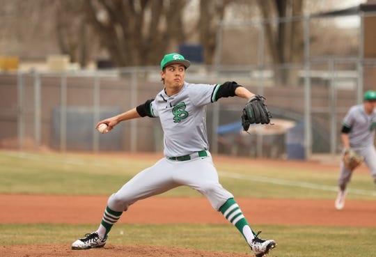Farmington's Jordan Vickers throws a pitch against Miyamura on Friday, Feb. 28, 2020, at Ricketts Park in Farmington. The 2020 spring sports campaigns came to a halt in mid-March and were canceled due to the COVID-19 pandemic.