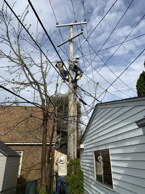 A DTE crew work on overhead infrastructure in Plymouth.