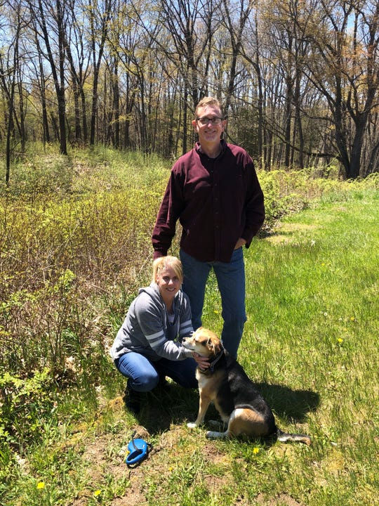 Brian and Kathy Durand of Livonia with Sparkles, their beagle mix, at Kensington Metropark in Milford on May 13, 2020.