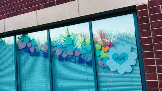 """""""Hearts for Hope"""" decorate Schoenberger's window at Aurora Medical Center in Oshkosh."""