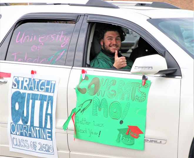 One graduate shares a smile during the car procession held as part of the Oak Harbor high School Class of 2020 ceremony on Sunday.