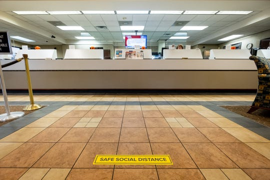 The floors in Eastern Michigan Bank in Port Huron are marked to help encourage social distancing.