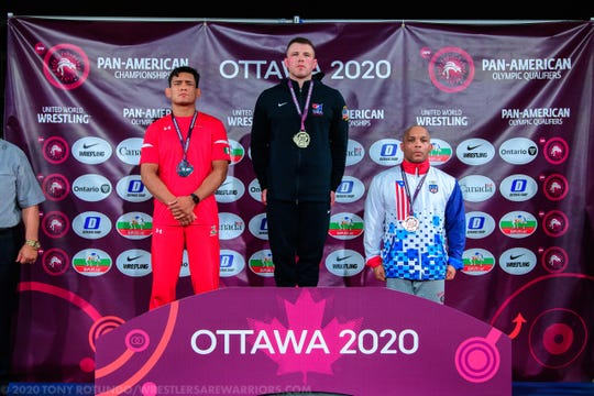 Kennard-Dale High graduate John Stefanowicz, center, receives the gold medal he won in the 82-kilogram (181-pound) class at the 2020 Pan An Games.