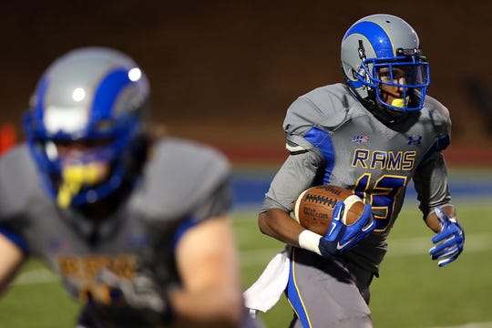 Angelo State University's Anthony Yancy sprints up the field on a kickoff return for a touchdown against Eastern New Mexico on Oct. 25, 2014.