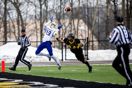 Angelo State's Anthony Yancy leaps into the frigid air to make a catch in the end zone for a touchdown during the Rams' NCAA Division II first-round playoff game against Michigan Tech in Houghton, Michigan, on Nov. 22, 2014.