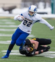 Angelo State's Ryan Byrd leaves a defender in his wake during the Rams' NCAA Division II first-round playoff game against Michigan Tech in Houghton, Michigan, on Nov. 22, 2014.