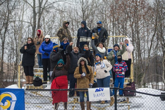A small crowd of Angelo State University fans cheer for the Rams during their 42-41 win over Michigan Tech on Nov. 22, 2014, in Houghton, Michigan, in the first round of the NCAA Division II playoffs.