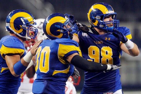 Angelo State's Clayton Callicutt (98) celebrates a strong defensive stand against Colorado State-Pueblo on Sept. 14, 2013.