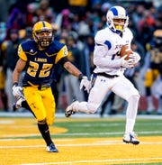 Angelo State University's Talon Smith races untouched for a 61-yard touchdown catch in the Rams' 35-33 win over Texas A&M-Commerce on Nov. 15, 2014.