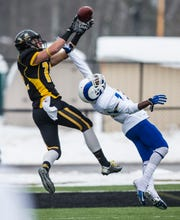 Angelo State's Jarred Ross is unable to stop a touchdown pass from Michigan Tech's Tyler Scarlett to Brandon Cowie on Nov. 22, 2014.