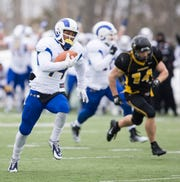 Angelo State's Talon Smith catches the ball on a quick slant and sprints down the field for a touchdown during the Rams' NCAA Division II first-round playoff game against Michigan Tech in Houghton, Michigan, on Nov. 22, 2014. Smith's catch, followed by a Peter Marquez extra point, gave the Rams a 42-41 lead with 3:31 remaining.