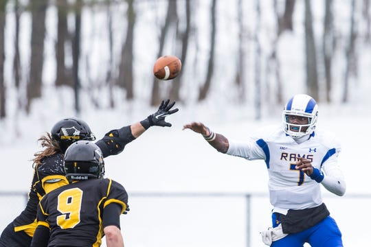 Angelo State's Kyle Washington fires a pass against Michigan Tech on Nov. 22, 2014.