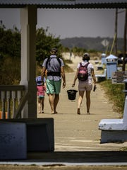 A family heads to the beach in Cape Charles after Northampton County began reopening as part of Gov. Ralph Northam's first phase of reopening the state after the coronavirus closure.